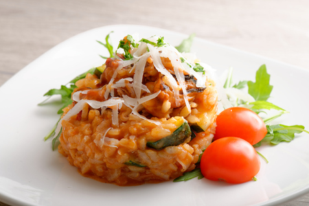 Delicious gourmet risotto with seafood, zucchinis and parsley photo