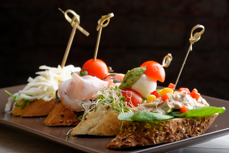 cazuela: Tapas on Crusty Bread - Selection of Spanish tapas served on a sliced baguette.