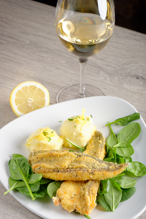 Dinner, Fish fillet with potato, young spinach and white wine photo