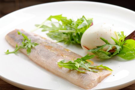 non vegetarian: Steamed fish fillet with egg, salad and fresh herbs