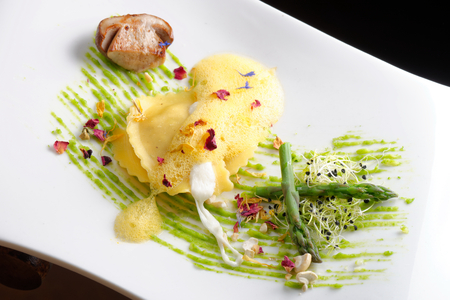 Fine dining, ravioli with asparagus and Porcini mushrooms photo