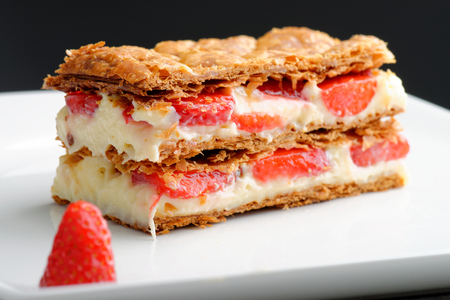 French gourmet strawberry mille feuille with whipped sour cream. Shallow dof. Stock Photo