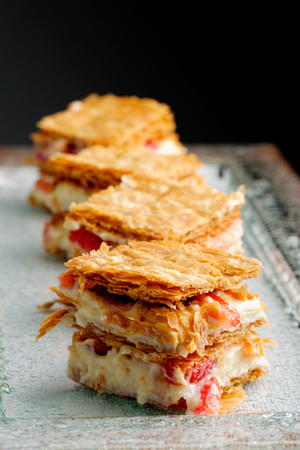 French gourmet strawberry mille feuille with whipped sour cream. Shallow dof.