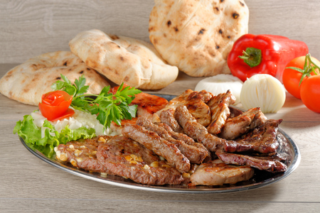 Wholesome platter of mixed meats including grilled steak