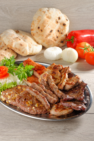 griller: Wholesome platter of mixed meats including grilled steak