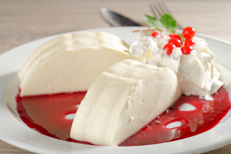 Italian dessert Panna cotta with red currant sorbet photo