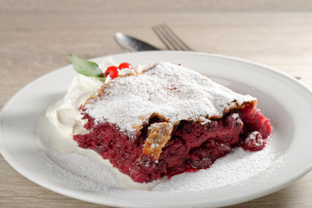 Homemade Strudel with cherries  German specialty photo