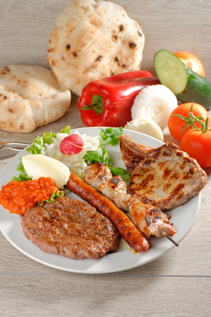 griller: Mixed grill on a plate, Balkan food (selective focus)