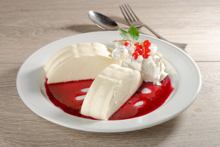 Panna cotta with red currant souce photo