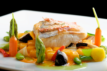 fine fish: Fine dining, White fish fillet breaded in herbs and spice with grilled bacon and vegetables