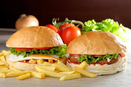 Veggie burgers with fresh vegetables and french fries photo
