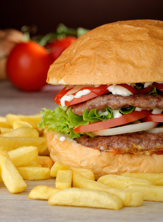 Big juicy double burger with french fries photo