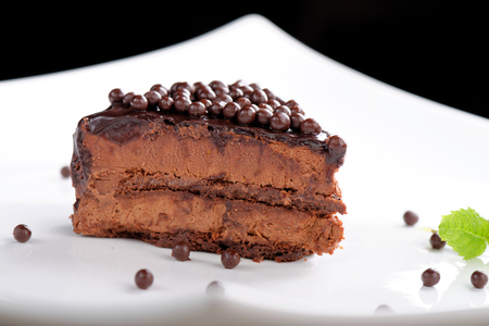 Fine dining, close up of a chocolate cream cake photo
