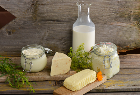 Organic dairy products on wooden table Standard-Bild