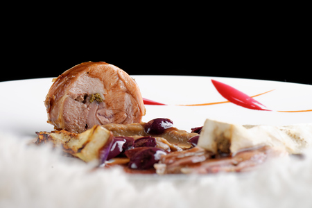 entree: Fine dining, gourmet Main Entree Course Grilled Lamb steak with olives and aubergines