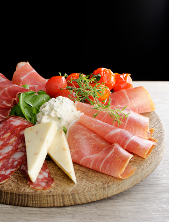 cheese platter: Arrangement of Delicatessen Cold Cuts with Smoked Ham, Cheese ,Pepperoni, Salami...