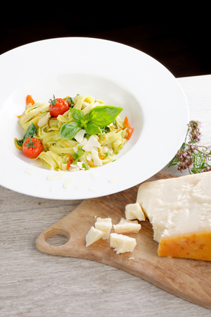 Mediterranean pasta with vegetables and cheese photo