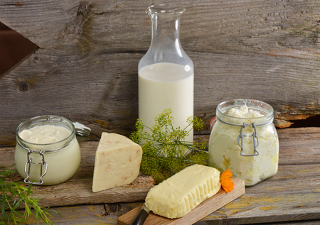 sour milk: Organic dairy products on wooden table Stock Photo