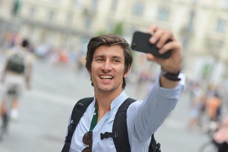 Student  tourist taking self portrait in the European city photo