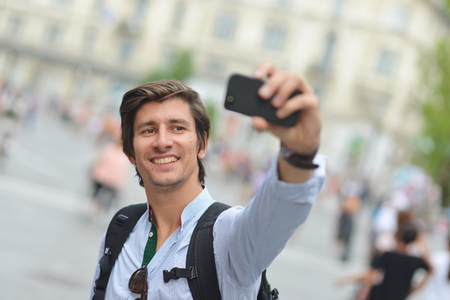 Student  tourist taking self portrait in the European city photo