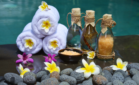 bathsalt: At the Spa, concept in a luxury Villa on Bali Island with, Massage oil, bath-salt, Volcanic stones, body scrub, Towels,Cinnamon sticks, Orchids and flowers. Stock Photo