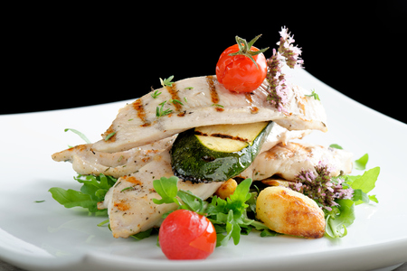 Fine dining  Grilled chicken fillet with fresh vegetables and potato photo