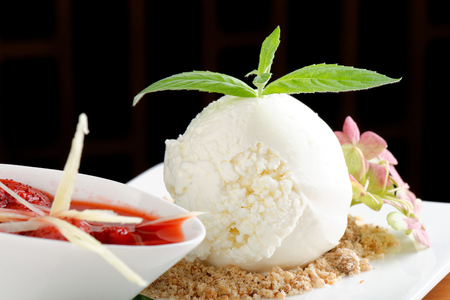 fine cuisine: White ice cream with hot strawberry sauce, ginger and green bell pepper  fine dining