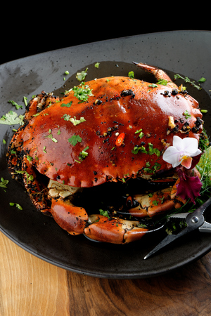 crab meat: Pepper sauce crab (Singaporean recipe) Stock Photo