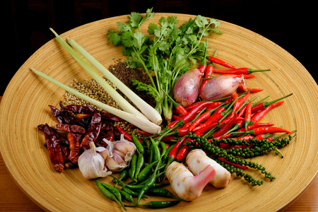 Asian herbs, spices and vegetables on the wooden plate photo