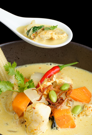 Traditional thai yellow curry with chicken photo