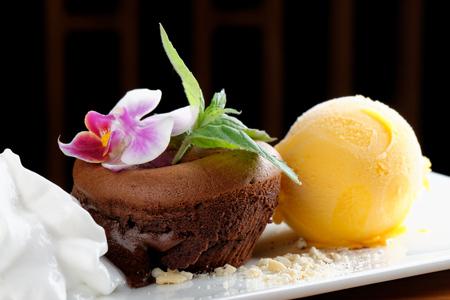 Fine dining, Chocolate souffle with mango ice cream and coconut foam  Fusion food photo