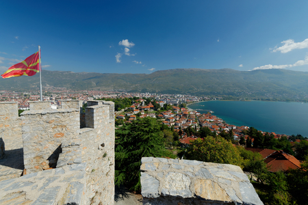 auspices: Aerial view of Ohrid Lake, city of Ohrid and mountains in the background. Ohrid is a Macedonian resort and famous tourist destination under the auspices of UNESCO