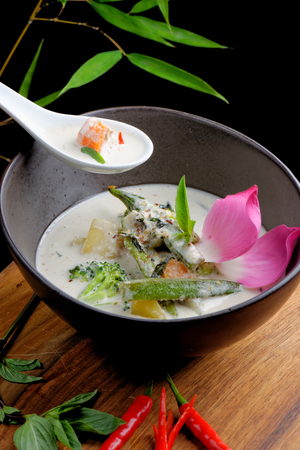 Traditional thai green curry with vegetables photo