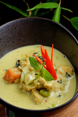 Traditional thai green curry with chicken photo