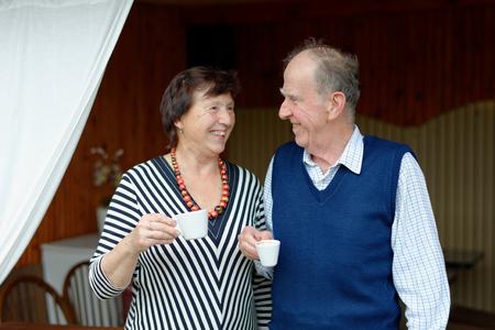 Senior Couple Enjoying Snack At Outdoor Cafe photo