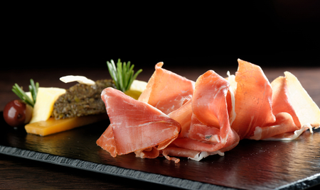 spanish food: Platter of serrano jamonProsciutto and olives pate Stock Photo