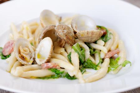 almejas: Spanish cuisine. Pasta with Clams and Chorizo, fishermans style. Almejas a la marinera.