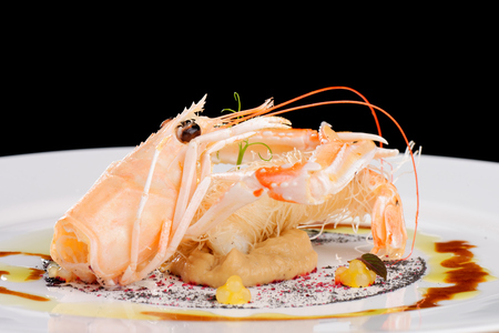 Fine dining Scampi  Norway lobster on Aubergine cream with tapioca photo