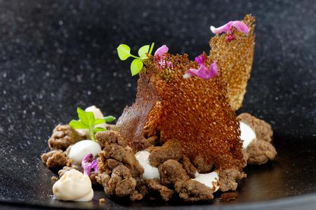 Delicious gourmet food, buckwheat mush witk caramel and fresh cheese