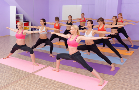 Bikram Hot Yoga Class instructor with students photo