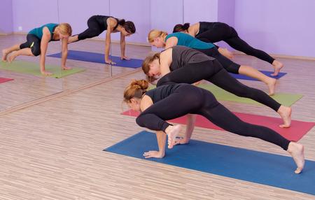 mat like: Bikram Hot Yoga Class instructor with students Stock Photo