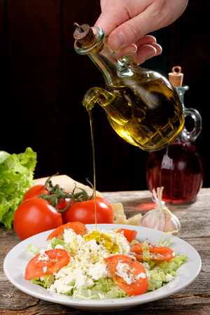 Fresh italian salad with mozzarella, tomato and olive oil photo