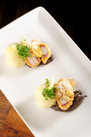 quid: Fried octopus with potato and sauce