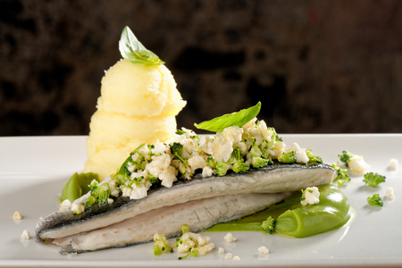Seabass fillet with vegetable and mashed potato photo