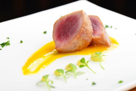 Japanese fine dining, Seared tuna steak called Sashimi traditional Japanese dish with wasabi sauce on side Standard-Bild