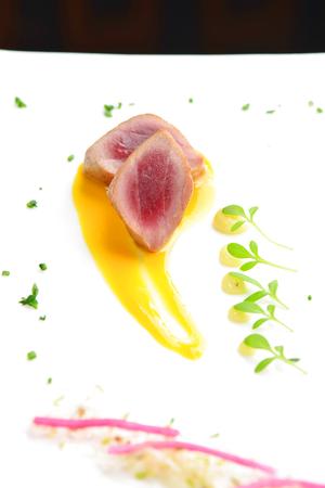 Japanese fine dining, Seared tuna steak called Sashimi traditional Japanese dish with wasabi sauce on side Imagens