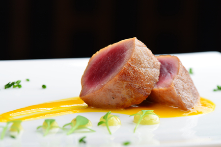 fine dining: Japanese fine dining, Seared tuna steak called Sashimi traditional Japanese dish with wasabi sauce on side Stock Photo