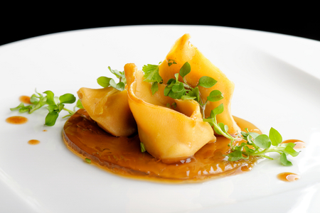 Fine dining, Lamb ragu ravioli on hay infusion jelly Stock Photo