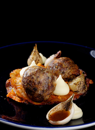 potatoe: Fine dining Gourmet Bloody sausageblack puding and sauerkraut with potatoe purree. Traditional german dish