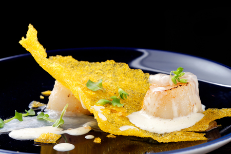 cuisine: Haute cuisine, Gourmet food scallops on a corn crunch Stock Photo